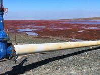 Река Далдыкан под Норильском окрасилась в красный цвет