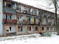 Жилой дом, пострадавший от обстрелов, в одном из районов в Донецке, 23 февраля 2017 года