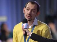 В Москве журналист УНИАН, представляющий агентство на пресс-конференциях Путина, задержан на интервью с аспирантом МГУ, вывесившим флаг Украины