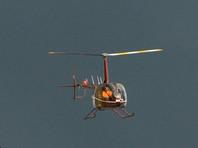 В ХМАО упал вертолет Robinson. Пилот и пассажир выжили