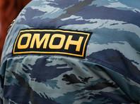 """Разыскиваемый Украиной командир """"Беркута"""" обнаружился на митинге в Москве в форме ОМОНа"""