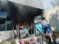 Пламя охватило, по меньшей мере, 25 жилых домов