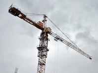Забравшиеся на башенный кран в Новосибирске строители добились выплаты долгов по зарплате (ФОТО)