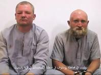 """Родственники опознали участников опубликованного """"Исламским государством""""* видео, в котором фигурируют двое якобы попавших в плен к террористам в Сирии россиян"""