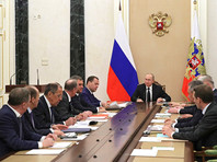 Путин обсудил с Совбезом РФ ситуацию в российско-британских отношениях