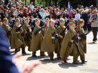 Администрация Пятигорска удалила из новостной публикации о параде дошкольных войск фотографию, на которой дети несут в руках модель американского автомата М16