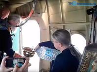 Тверь окропили с самолета 70 литрами святой воды для избавления от пьянства (ВИДЕО)