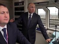 Путин в кабине машиниста открыл движение по железнодорожной части Крымского моста