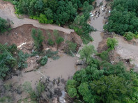 Подмосковье последние два дня страдает от проливных дождей. Самая сложная ситуация сложилась в городе Руза. Уровень реки Городянка достиг угрожающих отметок в ночь на 8 июля