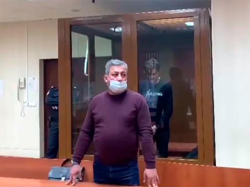 Павел Грин-Романов (на фото - за стеклом) в Пресненском районном суде, февраль 2021 года