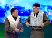 """В Северной Корее сняли 11-й сатирический выпуск программы """"Сцена оптимизма от Сонгуна"""", высмеивающий американского президента Барака Обаму и главу аппарата Белого дома Дениса Макдоно"""