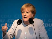 """Меркель откажется от использования своего лозунга """"Мы справимся"""""""