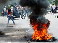 При подавлении беспорядков в Венесуэле погиб полицейский, более сотни протестующих пострадали
