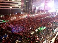 В Сеуле пятую неделю продолжатся невиданные по масштабу массовые протесты с требованием отставки вовлеченной в коррупционный скандал президента Южной Кореи Пак Кын Хе