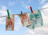 """""""Глобальная прачечная"""" - крупнейшая в истории Восточной Европы преступная схема по отмыванию денег, в которую входили подставные британские компании, российские банкиры и суды в Молдавии"""
