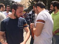 В Сирии началась массовая раздача георгиевских ленточек