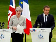 Тереза Мэй и Эмманюэль Макрон на переговорах в Париже