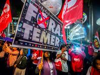 BBC отмечает, что Темер крайне непопулярен в Бразилии, треть его кабинета министров находится под следствием в связи с подозрениями в коррупции. Оппозиционные партии требуют импичмента и новых выборов главы государства