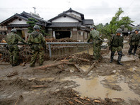 Число жертв наводнения в Японии достигло 18 человек