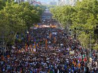 Десятки тысяч вышли на марш против террора в Барселоне
