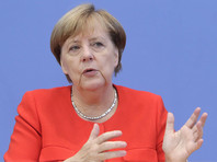 Меркель сообщила, когда будут отменены санкции ЕС против России