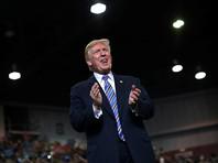 """Президент США Дональд Трамп обвинил представителей Демократической партии в том, что они разжигают слухи о якобы имевших место контактах его администрации с Россией, и назвал подобную информацию """"полной фальсификацией"""" и ложью"""