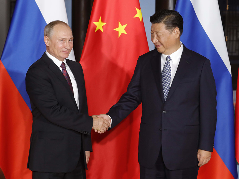 Президент России Владимир Путин и председатель Китая Си Цзиньпин встретились в канун саммита БРИКС