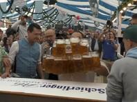 В Баварии поставлен  новый рекорд по переносу  пива - 29 кружек за раз
