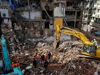 Число жертв обрушения в Мумбаи достигло 34, под угрозой жители 25000 домов