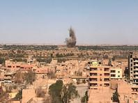 Вид на район Джафра в Дейр-эз-Зоре, где продолжаются бои между сирийской армией и боевиками запрещенной в России организации ИГИЛ, 23 сентября 2017 года