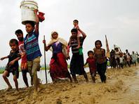 В Мьянме официальные власти обвиняют мусульман-рохинджа в отрубании голов статуям Будды, беженцы говорят об отрубленных головах младенцев