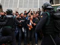 В Каталонии десятки пострадавших из-за противодействия полиции референдуму
