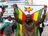 """Тысячи жителей страны вышли на улицы города с национальными флагами. """"Это слезы радости, - цитирует агентство одного из участников марша. - Я ждал этого дня всю свою жизнь. Наконец он настал - день нашей свободы!"""""""