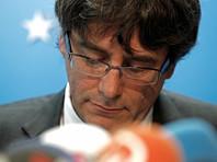 Бывшие каталонские министры вернулись в Барселону из Брюсселя без Пучдемона