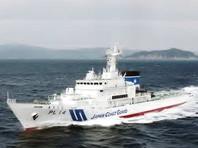 У побережья Японии выловили тело со значком с Ким Ир Сеном
