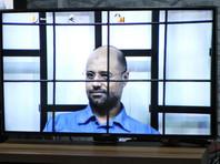 """Контролирующая Зинтан вооруженная группировка """"Абу Бакр ас-Сиддик"""" в течение шести лет удерживала сына Каддафи под стражей и отпустила его на свободу в июне этого года в связи с объявленной ливийским парламентом всеобщей амнистией"""