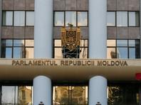 """Закон об """"антипропаганде"""" был принят парламентом Молдавии в начале декабря 2017 года. Президент дважды его отклонял, несмотря на то, что по закону, он был обязан утвердить его во второй раз"""