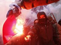 Украинские националисты забросали камнями здание Россотрудничества и офисы двух банков