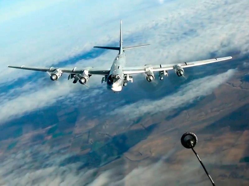 Американские истребители F-22 вылетели на перехват двух российских стратегических бомбардировщиков-ракетоносцев Ту-95 в небе к западу от побережья штата Аляска