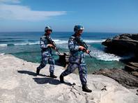 Пекин обвинил корабли США, прошедшие у спорных островов, во вторжении в территориальные воды Китая
