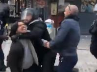 Советника президента Франции уличили в избиении митингующего на акции в Париже (ВИДЕО)