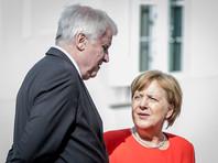 Глава МВД Германии и Меркель договорились по вопросу мигрантов
