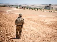 Американский солдат у деревни в районе сирийского города Манбидж, 26 июня 2018 года
