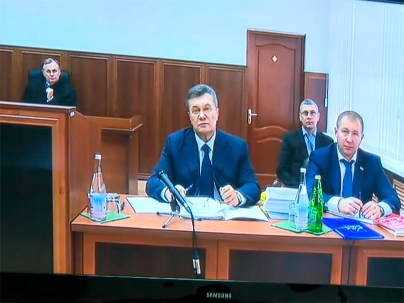 """Суд Киева приговорил экс-президента Януковича к 13 годам тюрьмы за госизмену"""" />"""