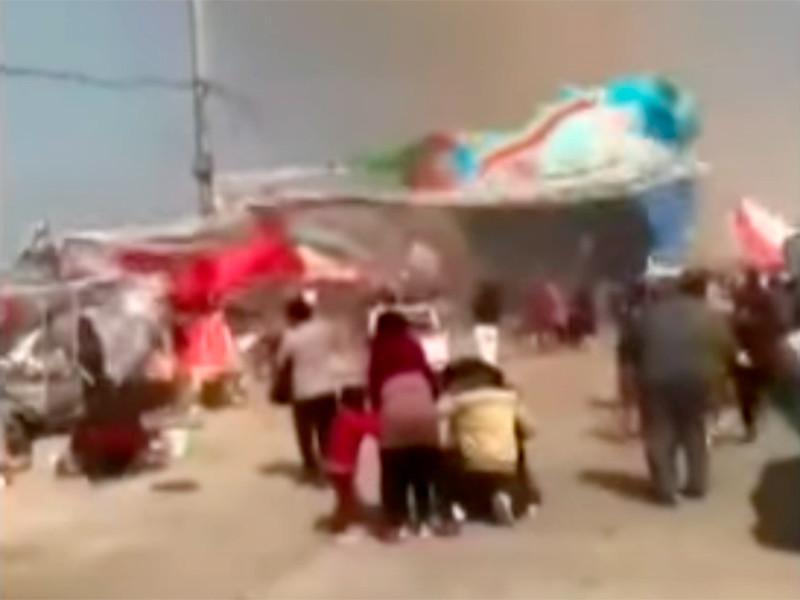 """В Китае пыльный вихрь поднял в воздух надувные батуты с детьми: 2 погибших, 18 раненых (ВИДЕО)"""" />"""