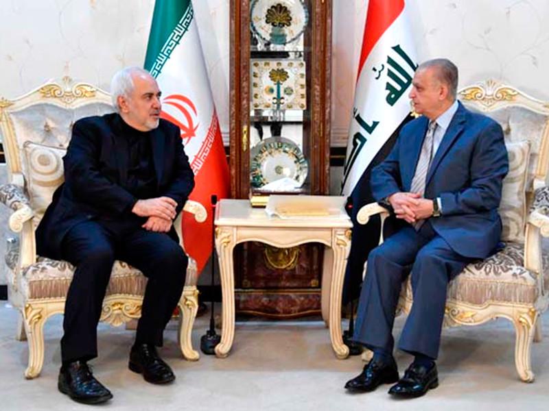 """""""Мы пытаемся помочь и выступить посредниками"""", - сказал глава МИД Ирака Мухаммед Али аль-Хаким( на фото - справа) в ходе встречи со своим иранским коллегой Мохаммадом Джавадом Зарифом"""