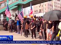 """""""В последнее время благодаря тому, что запечатлели СМИ, мы постоянно убеждались в том, что среди агрессивно настроенных участников протестов было немало американских лиц, и даже промелькнул флаг США, - отметила она на регулярном брифинге. - У всех возник вопрос: какую же на самом деле роль сыграли Соединенные Штаты в том, что произошло в Гонконге?"""""""
