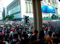Демонстранты в Гонконге провели новую акцию протеста - теперь в материковой части города
