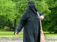 Запрет, введенный после многолетних споров, касается ношения таких предметов гардероба, как например, мусульманское покрывало - паранджа, а также никаб