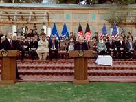 На подписании соглашения в столице Катара Дохе присутствовали госсекретарь США Майк Помпео, министр обороны Марк Эспер, президент Афганистана Мохаммад Ашраф Гани, генеральный секретарь НАТО Йенс Столтенберг, представители более 30 стран